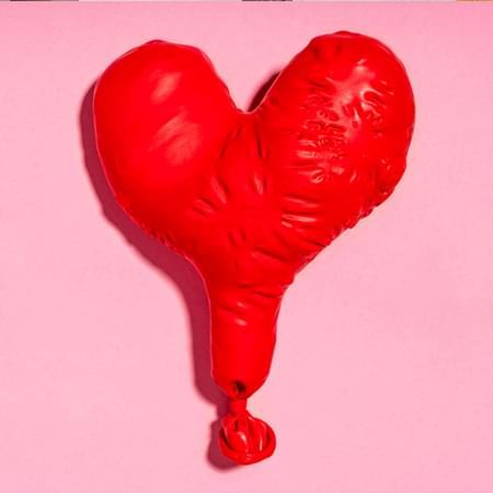 pink background with a red balloon heart