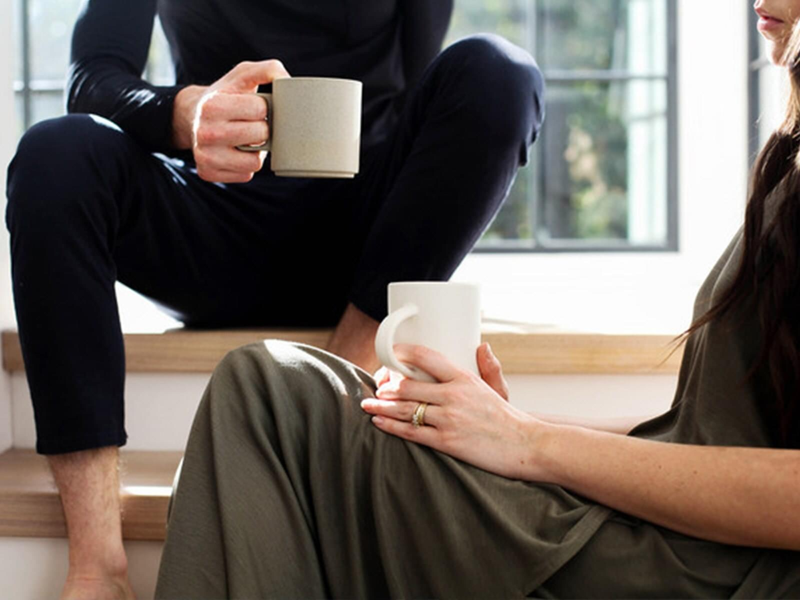 2 people with coffee on their knee