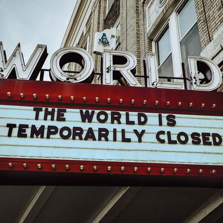 Old theatre billboard sign with the words the world is unavailable