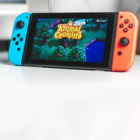 Nintendo games console with animal crossing game on screen