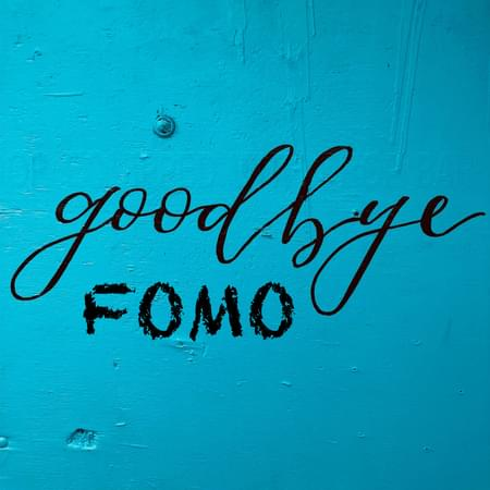 blue back ground with handwritten text goodbye and fomo