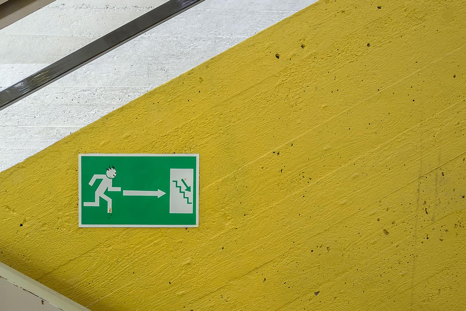 Stark shapes with yellow and white stripes and an exit sign