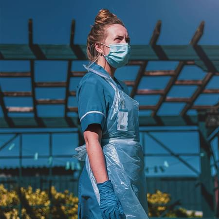 female nurse wearing a ppe face mask