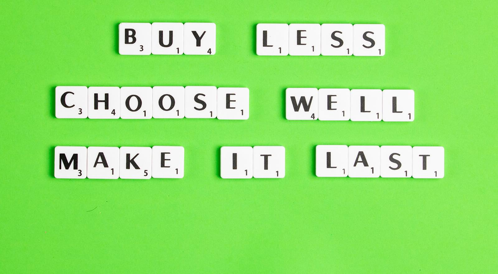 green back ground with scrabble pieces spelling out buy less choose well