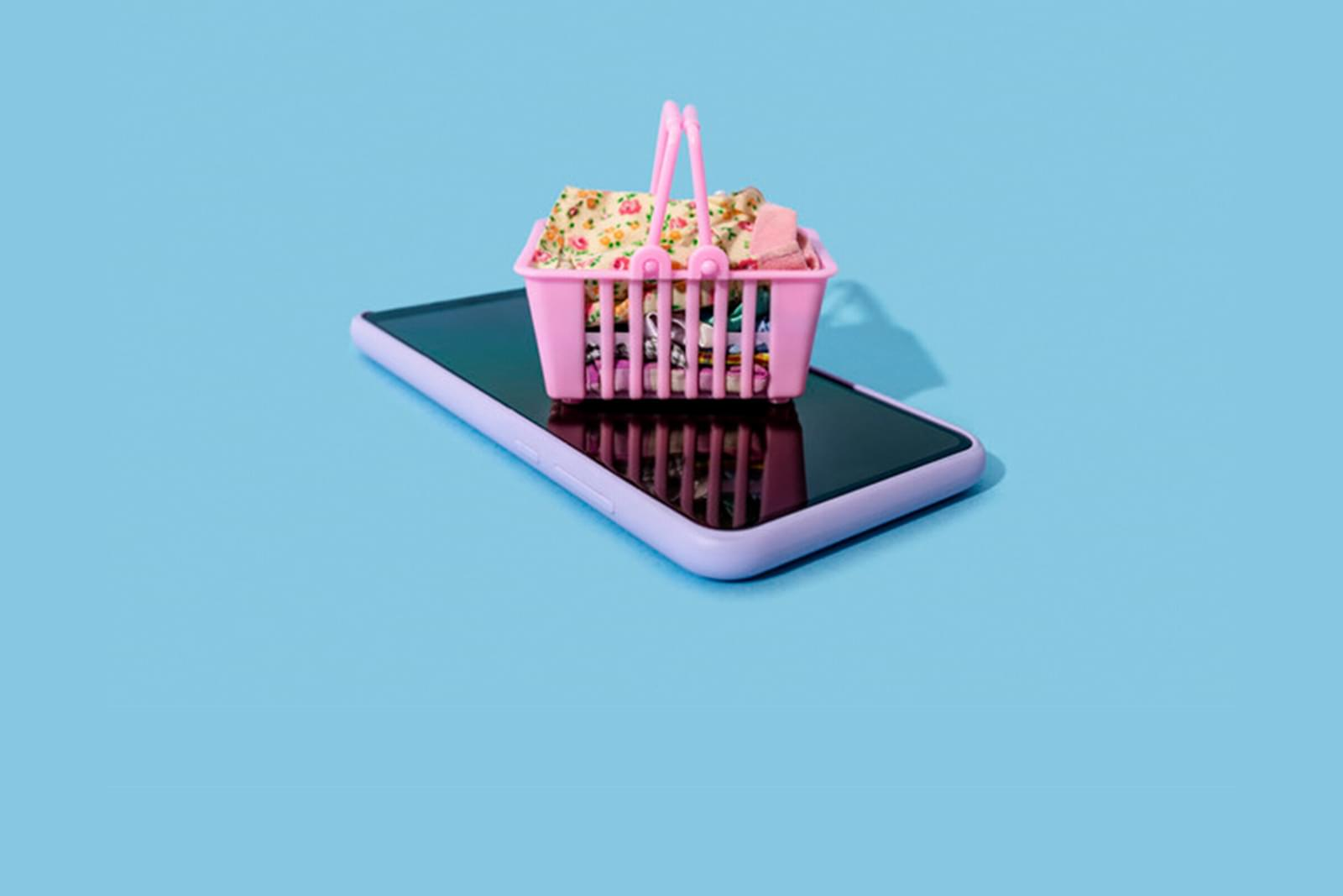 a small shopping basket on top of a mobile phone