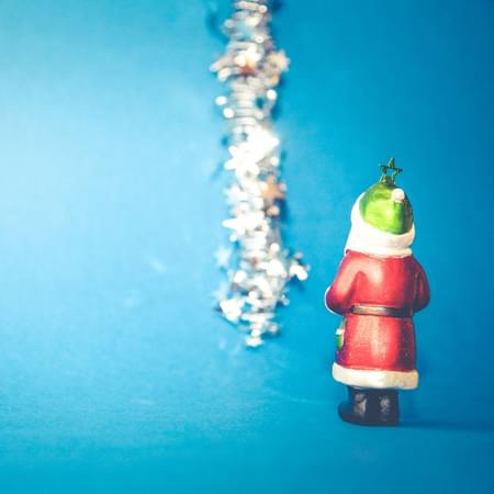 father christmas blue background with tinsel