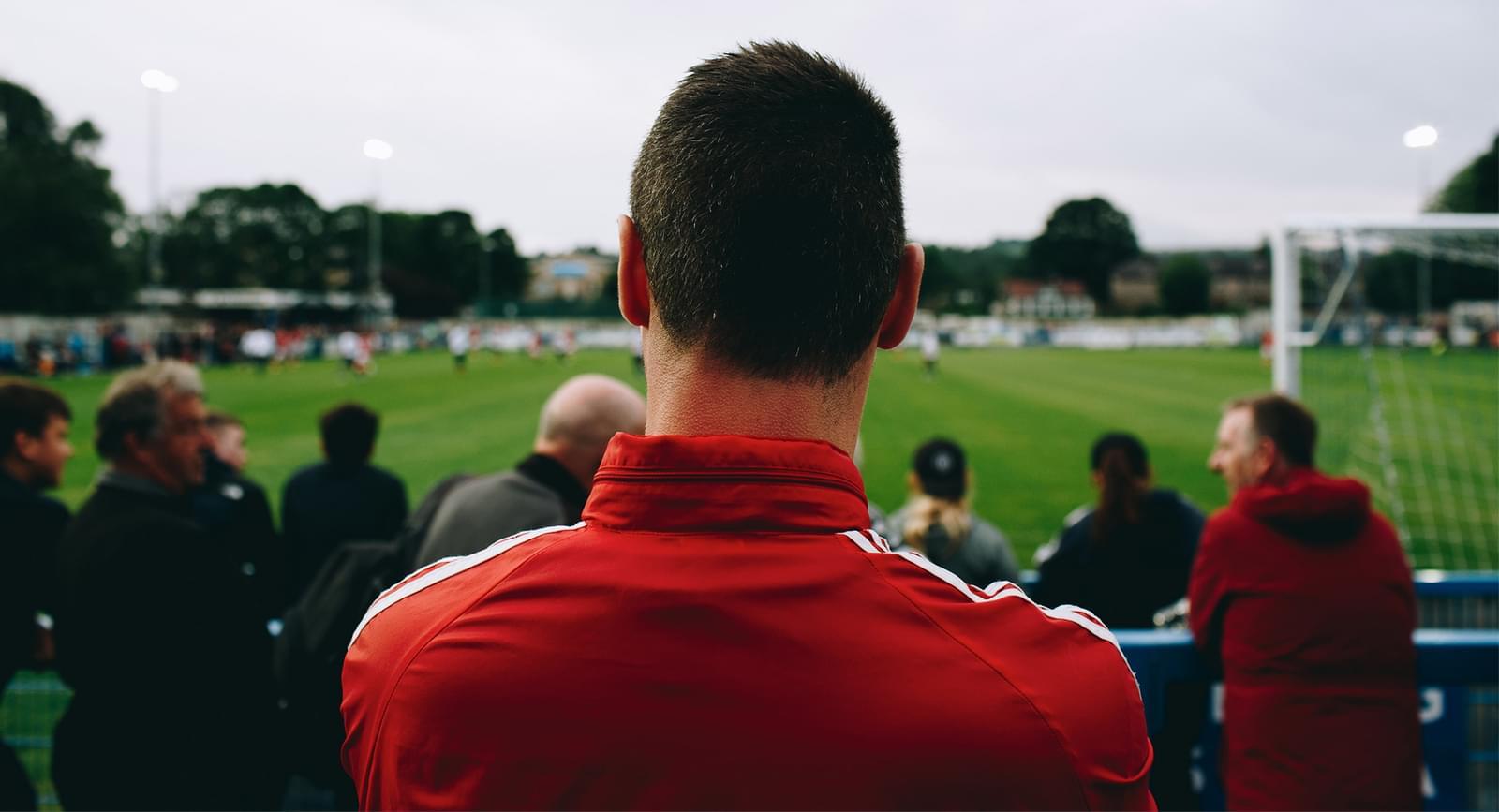Fan watching a football game.