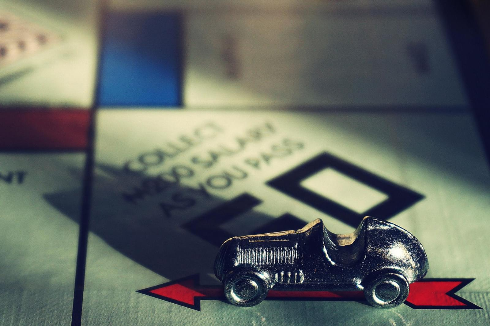 monopoly board games with a pewter car